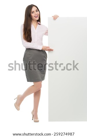 Young woman holding blank poster  - stock photo