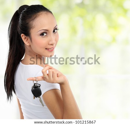 young woman holding car key . copy space - stock photo