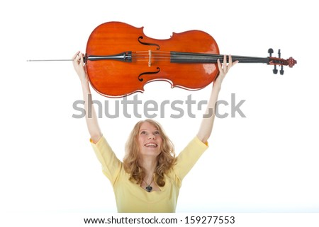 young woman holding cello up in the air and white background - stock photo
