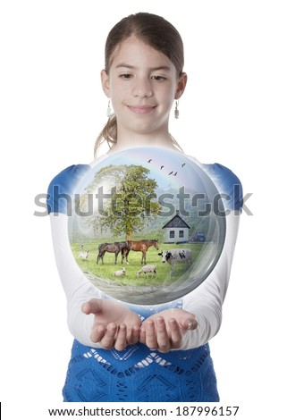 Young woman holding farm globe on isolated white background - stock photo