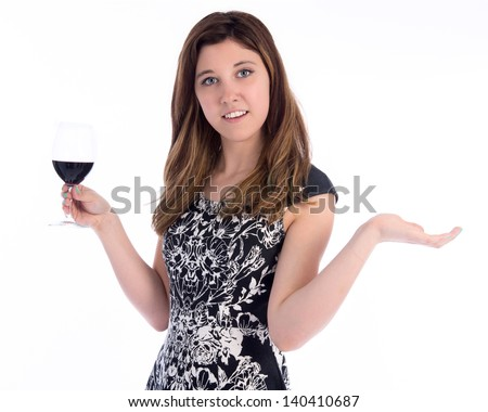 Young woman holding glass on wine with her hands spread wide in expectation - stock photo