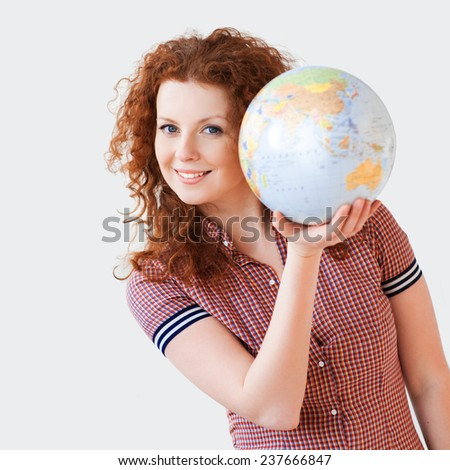 Young woman holding globe - stock photo