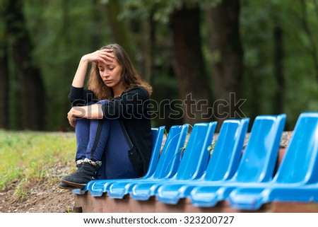 Young woman holding her head in despair. - stock photo