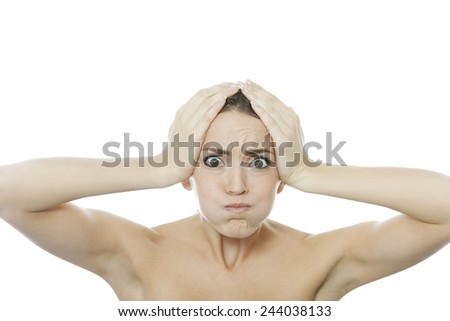 Young woman holding her head looking worried or annoyed - stock photo