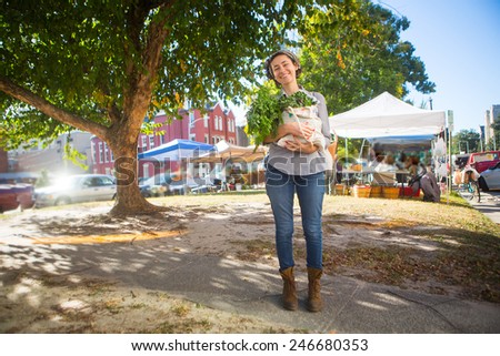 young woman holding her healthy food from the farmer's market - stock photo