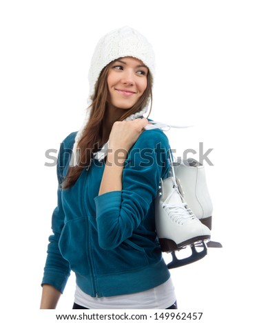 Young woman holding ice skates for winter ice skating sport activity in white hat smiling isolated on a white background - stock photo
