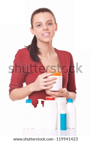 young woman holding in hand blank bottle cream - stock photo