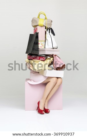 Young woman holding many shopping bags - stock photo