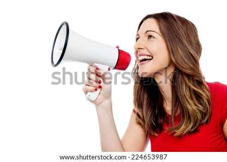 Young woman holding megaphone over white - stock photo