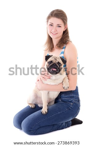 young woman holding pug dog isolated on white background - stock photo