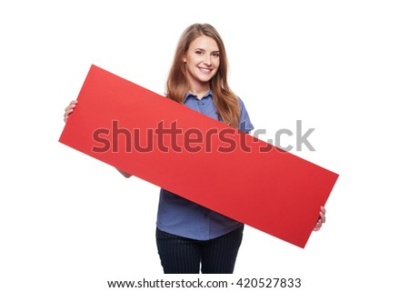 Young woman holding red blank cardboard, over white background - stock photo