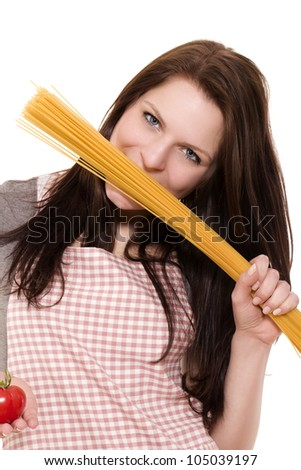 young woman holding spaghetti to her face holding tomato on white background - stock photo