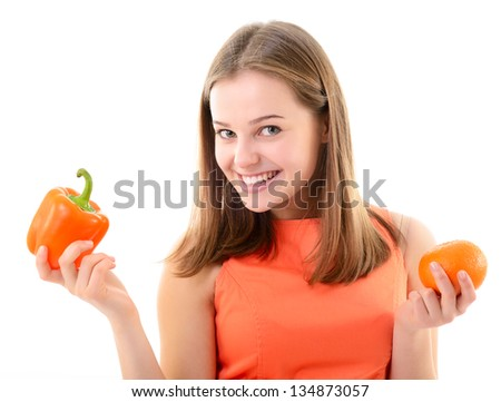 Young woman holding sweet pepper and mandarin, orange mood, diet and vegetarian concept, over white - stock photo
