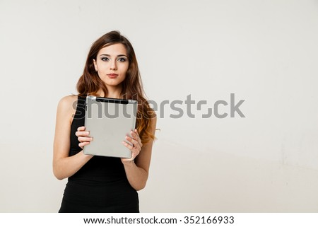 young woman holding tablet pc  - stock photo