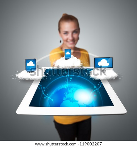 Young woman holding tablet with abstract clouds and modern devices - stock photo