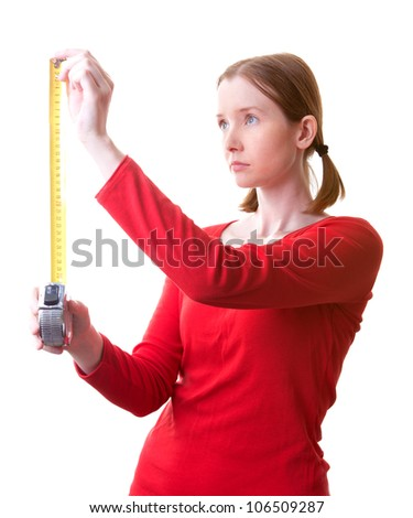 Young woman holding tape measure, isolated on white - stock photo