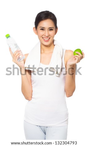 Young woman holding towel and smiling - stock photo