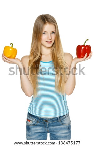 Young woman holding two sweet peppers, over white - stock photo