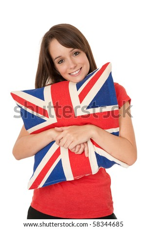 Young woman holding Union Jack cushion - stock photo