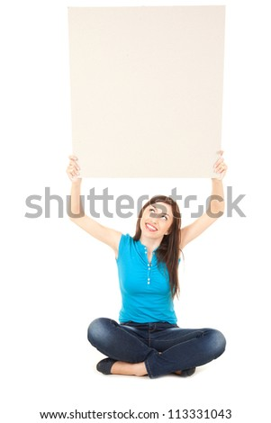 young woman holding up blank sign above his head an looking up, full length, white background - stock photo
