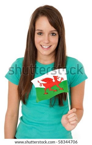 Young woman holding Welsh flag isolated on white - stock photo