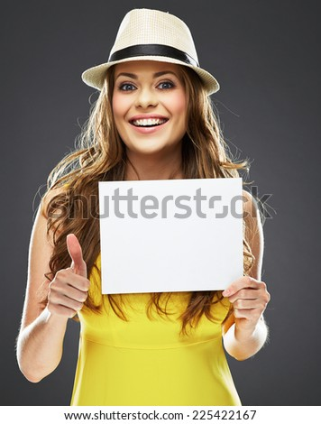 young woman holding white blank board . yellow dress . - stock photo