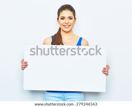 young woman holding white blank signboard. studio portrait on white background. - stock photo