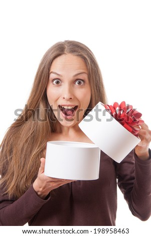 young woman holding white round gift box, isolated on white - stock photo