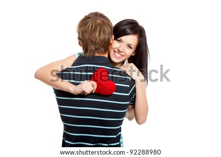 young woman hug man holding red heart, happy love couple, smile attractive girl looking at camera, isolated over white background, valentine day concept - stock photo