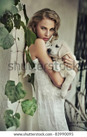 Young woman hugging her puppy - stock photo