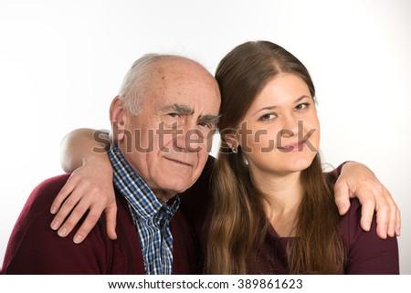 young woman hugging old senior man - stock photo