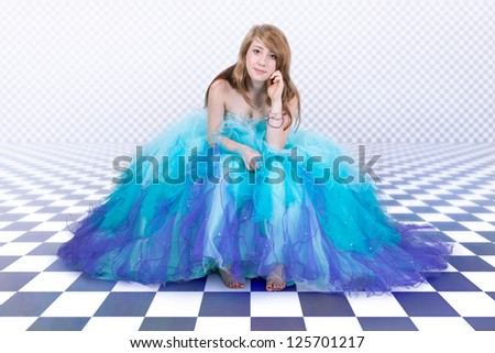 Young woman in a beautiful blue tulle dress - stock photo