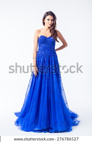 Young woman in a beautiful evening dress - stock photo