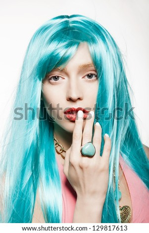 young woman in a bright turquoise wig, indoor - stock photo
