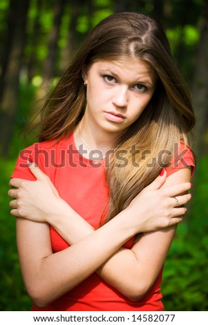 Young woman in a forest. - stock photo