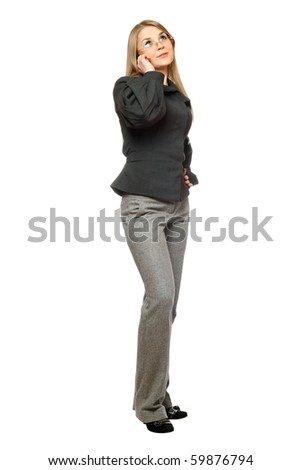 Young woman in a gray business suit talking on the phone - stock photo