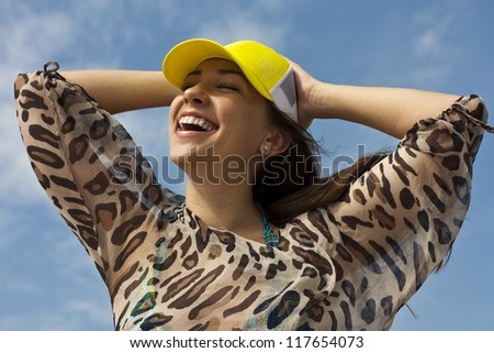 Young woman in a hat. Beach, summer, sun - stock photo