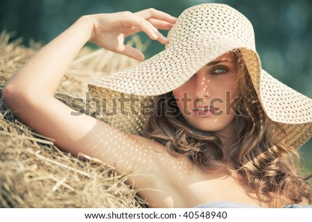 Young woman in a hat portrait. Soft colors. - stock photo