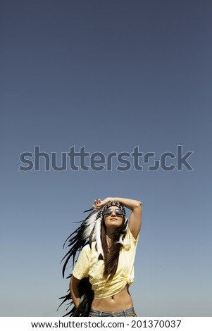 Young woman in a headdress  . - stock photo