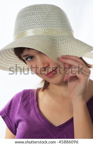 Young woman  in a  in a straw hat - stock photo