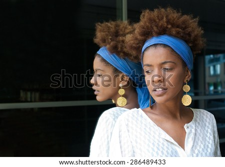 young woman in a mirror - stock photo