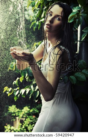 Young woman in a rain forest - stock photo
