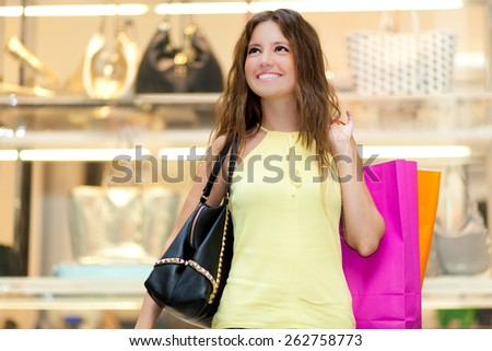 Young woman in a shopping center - stock photo