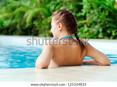 Young woman in a swimming pool. - stock photo