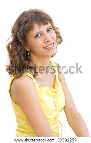 Young woman in a yellow dress on a white background - stock photo