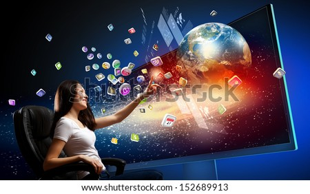 Young woman in armchair pushing icon on media screen. Elements of this image are furnished by NASA - stock photo