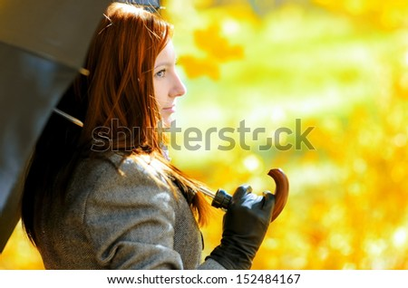 Young woman in autumn park. Outdoor portrait. - stock photo