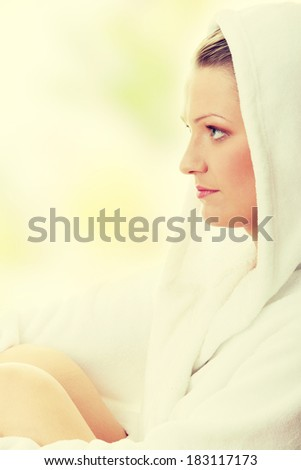 Young woman in bathrob isolated - stock photo