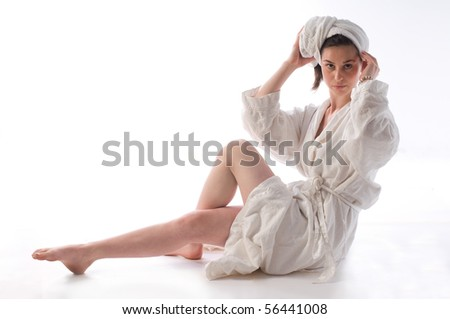 Young woman in bathrobe and towel on head - stock photo