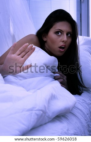Young woman in bed abused at night - stock photo